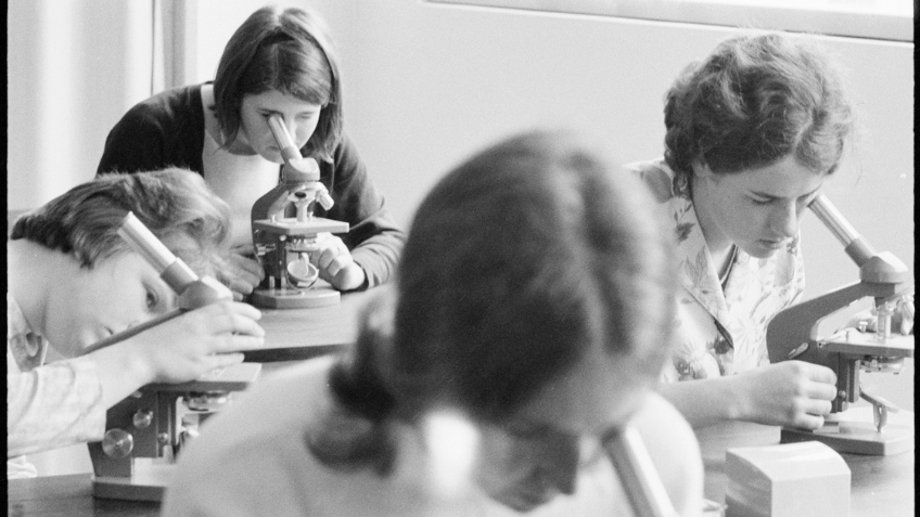 Black and white photo of young students in a science lab