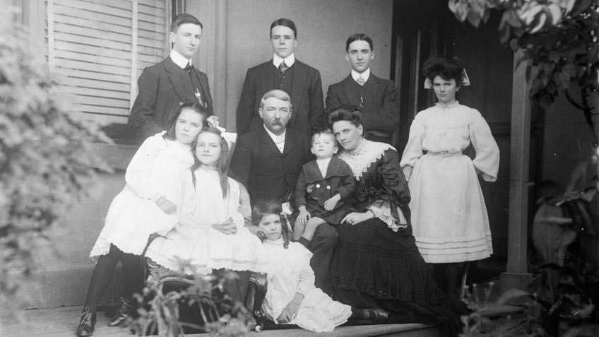 Black and white photographic portrait of an extended family