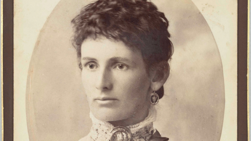 Sepia portrait of a woman in Victorian clothes