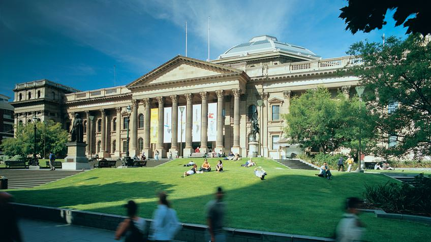 State Library Victoria's stately facade and lush front lawn