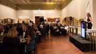 Speaker addresses diners in Cowen Gallery