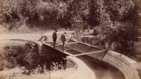 Two men standing on aqueduct