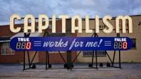 Large capitalism sign
