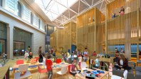 architects' mock-up of children's library space with children and parents and brightly coloured furnishings
