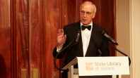 Former Prime Minister Paul Keating stands on a podium at State Library Victoria
