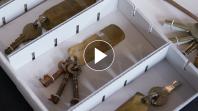 A white box full of old keys