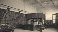sepia photo of library room with ornate ceiling and shelves of books
