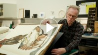 Man constructing book cradle