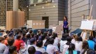 children's host presenting to seated children