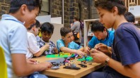 children making and creating at tables