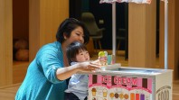 mother and child playing with toy ice cream