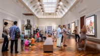 architects' mock-up of galleried library space with people admiring artworks and installations including Ned Kelly armour