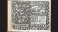 Two pages of a book are open to show ornate printed text and a detailed woodcut
