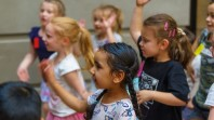 children dancing and clapping hands