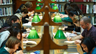 Library users researching in the La Trobe Reading Room