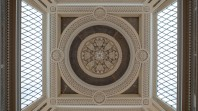 looking up to filligree skylights and coffered ceiling