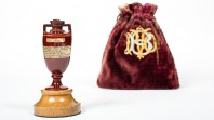 tiny antique urn and red velvet bag embroidered with MCC logo