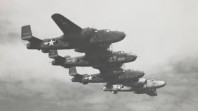 Four B17 bombers in flight during World War II, probably near Borneo