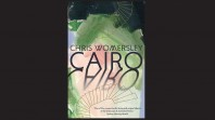 Book cover against black background with green, pink and blue paint, drawing of spiral stairs and the words Cairo, Chris Womersley