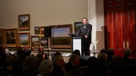 Photo of a man giving a presentation to a crowd in Cowen gallery