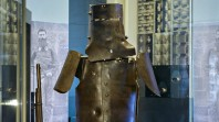 close-up of Ned Kelly armour in glass display case