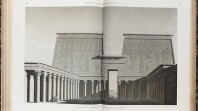 Pages of an open book display a b&w photo of a grand Egyptian temple