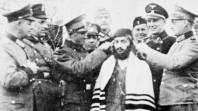 SS guards humiliating Orthodox Jewish man