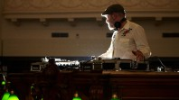 Photo of a DJ in the centre of La Trobe reading room