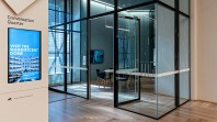 A meeting room with glass windows and doors