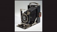 antique shutter camera on white background with black borders