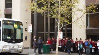 School students lining up outside the State Library's conference centre entrance on La Trobe Street