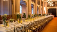 Photo of Queen's Hall set up with a long table