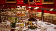 Photo of high tea set up on tables in the Red Rotunda