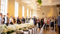 Victoria Gallery event with guests surrounding long formal table listening to speakers