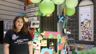 A young woman stands in the colourful children's space at the Library