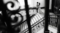 Black and white photo of a couple on some stairs in the library