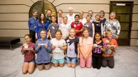 Children at State Library Victoria receiving Young Researcher Fellowship awards