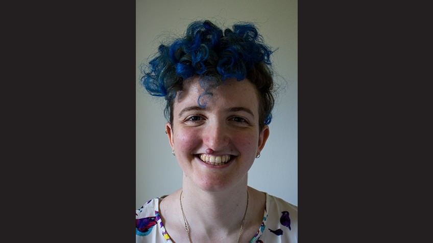 close up portrait of young female author with blue hair