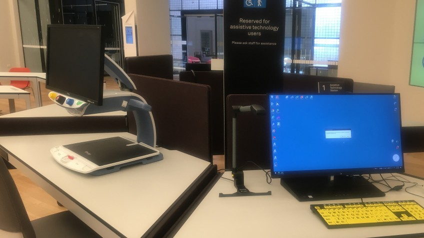 Workstation with assistive technology and large keyboard