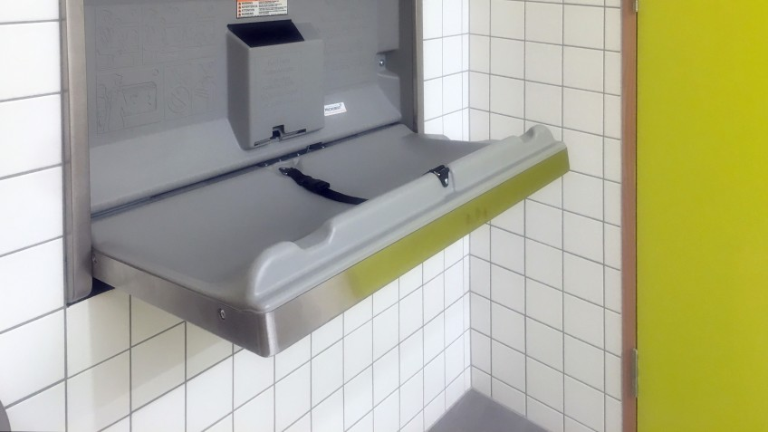 Baby change table in a tiled room