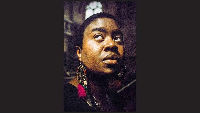 dramatically lit portrait of writer Maxine Beneba Clarke