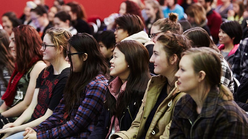 Colour shot of an audience of teenaged girls