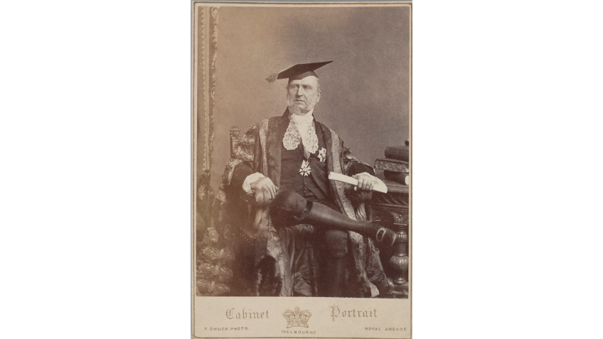 Sepia photo of a man in long robes