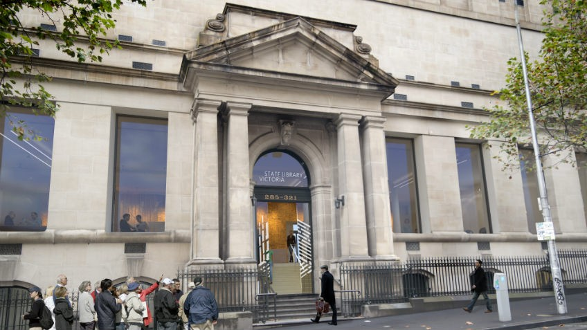 architects' mock-up of library entrance on city street with portico, steps and people queuing