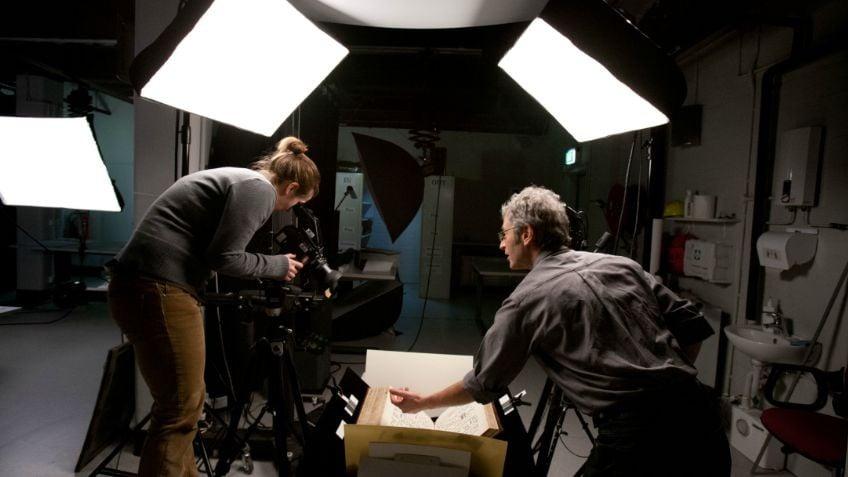 Image of two people working in the digital imaging studio