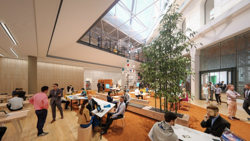 architects' mock-up of shared work space with central light well, people seated at shared tables, indoor plants and laptops