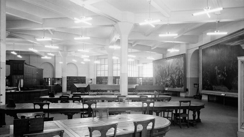 fluoro-lit basement newspapers reading room