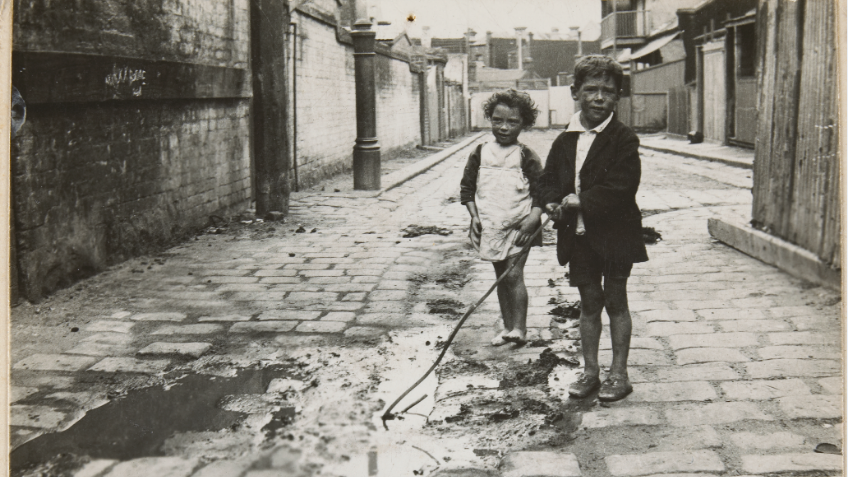 Black and white photo of two young children