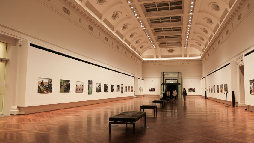 Side shot of wide room with images displayed