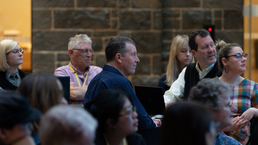 close-up of audience against bluestone wall